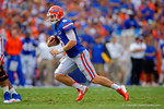 Florida Gators quarterback Jeff Driskel keeps the snap and scrambles to his right.  Florida Gators vs Eastern Michigan Eagles.  September 6th, 2014. Gator Country photo by David Bowie.