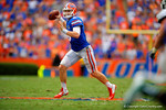 Florida Gators quarterback Jeff Driskel rolls to his right and throws downfield.  Florida Gators vs Eastern Michigan Eagles.  September 6th, 2014. Gator Country photo by David Bowie.