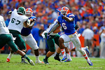 Florida Gators defensive lineman Dante Fowler, Jr. rushes upfield toward the Eastern Michigan quarterback.  Florida Gators vs Eastern Michigan Eagles.  September 6th, 2014. Gator Country photo by David Bowie.