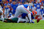 Florida Gators defensive lineman Caleb Brantley makes the tackle on an Eastern Michigan player causing a fumble.  Florida Gators vs Eastern Michigan Eagles.  September 6th, 2014. Gator Country photo by David Bowie.