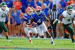 Florida Gators wide receiver Andre Debose takes the punt return upfield.  Florida Gators vs Eastern Michigan Eagles.  September 6th, 2014. Gator Country photo by David Bowie.