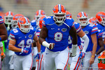 Florida Gators defensive lineman Leon Orr and the Florida Gators sprint into the locker room at the end of warmups.  Florida Gators vs Eastern Michigan Eagles.  September 6th, 2014. Gator Country photo by David Bowie.