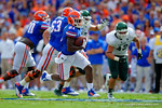Florida Gators running back Kelvin Taylor sprints out of the background and downfield into the endzone.  Florida Gators vs Eastern Michigan Eagles.  September 6th, 2014. Gator Country photo by David Bowie.