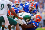 Florida Gators defensive lineman Dante Fowler, Jr. and Florida Gators defensive lineman Leon Orr combine to make the tackle.  Florida Gators vs Eastern Michigan Eagles.  September 6th, 2014. Gator Country photo by David Bowie.