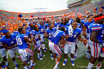 The Florida Gators celebrate in the north endzone with the band and students following their win over Eastern Michigan.  Florida Gators vs Eastern Michigan Eagles.  September 6th, 2014. Gator Country photo by David Bowie.