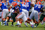 Florida Gators running back Matt Jones bounces around the outside and rushes upfield.  Florida Gators vs Eastern Michigan Eagles.  September 6th, 2014. Gator Country photo by David Bowie.