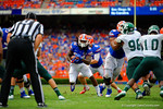 Florida Gators running back Matt Jones gets the hand off and sprints up the middle through the open gap.  Florida Gators vs Eastern Michigan Eagles.  September 6th, 2014. Gator Country photo by David Bowie.