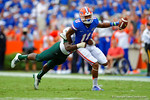 Florida Gators wide receiver Demarcus Robinson makesthe grab, turns, and sprints downfield before being tackled by Eastern Michigan defensive back Ray Tillman.  Florida Gators vs Eastern Michigan Eagles.  September 6th, 2014. Gator Country photo by David Bowie.