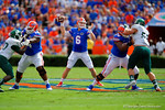 Florida Gators quarterback Jeff Driskel throws downfield with the help of the blocks by Florida Gators lineman Trenton Brown and Max Garcia.  Florida Gators vs Eastern Michigan Eagles.  September 6th, 2014. Gator Country photo by David Bowie.