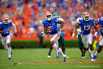 Florida Gators safety Duke Dawson intercepts the ball and returns it for a touchdown.  Dawson is the first Gator ever to return an interception for a touchdown in his first game.  Florida Gators vs Eastern Michigan Eagles.  September 6th, 2014. Gator Country photo by David Bowie.