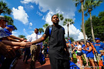 Florida Gators defensive lineman Gerald Willis and the Florida Gators march into Ben Hill Griffin Stadium greeting the Florida fans before the start of the game versus the Idaho Vandals.   Florida Gators vs Idaho Vandals.  August 30th, 2014. Gator Country photo by David Bowie.