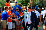 Florida Gators Head Coach Will Muschamp and the Florida Gators march into Ben Hill Griffin Stadium greeting the Florida fans before the start of the game versus the Idaho Vandals.   Florida Gators vs Idaho Vandals.  August 30th, 2014. Gator Country photo by David Bowie.