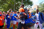 Florida Gators defensive lineman Dante Fowler, Jr. and the Florida Gators march into Ben Hill Griffin Stadium greeting the Florida fans before the start of the game versus the Idaho Vandals.   Florida Gators vs Idaho Vandals.  August 30th, 2014. Gator Country photo by David Bowie.