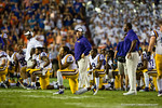 The LSU players and head coach Les Miles watch on as the Florida Gators tend to Florida Gators wide receiver Latroy PittmanFlorida Gators vs LSU Tigers.  October 11th, 2014. Gator Country photo by David Bowie.