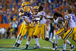 The LSU Tigers sideline clears as they come out to celebrate the game winning field goal made by kicker Colby Delahoussaye.  Florida Gators vs LSU Tigers.  October 11th, 2014. Gator Country photo by David Bowie.