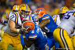 LSU Tigers offensive lineman Ethan Pocic knocks Florida Gators defensive lineman Dante Fowler, Jr. to the ground during the second quarter.  Florida Gators vs LSU Tigers.  October 11th, 2014. Gator Country photo by David Bowie.