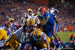 LSU Tigers running back Leonard Fournette leaps up and over the pile for a touchdown during the third quarter.  Florida Gators vs LSU Tigers.  October 11th, 2014. Gator Country photo by David Bowie.