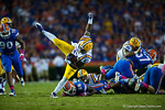 LSU Tigers running back Kenny Hilliard is upended by Florida Gators defensive back Marcus Maye.  Florida Gators vs LSU Tigers.  October 11th, 2014. Gator Country photo by David Bowie.