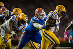 Florida Gators defensive lineman Caleb Brantley attempts to tackle LSU Tigers running back Leonard Fournette during the third quarter.  Florida Gators vs LSU Tigers.  October 11th, 2014. Gator Country photo by David Bowie.
