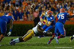Florida Gators quarterback Jeff Driskel is hit by LSU Tigers linebacker Kwon Alexander knocking the ball loose and leading to a Gator turnover.  Florida Gators vs LSU Tigers.  October 11th, 2014. Gator Country photo by David Bowie.
