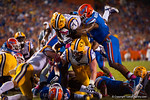 LSU Tigers running back Leonard Fournette leaps up and over the pile into the endzone to put the Tigers into the lead during the third quarter.  Florida Gators vs LSU Tigers.  October 11th, 2014. Gator Country photo by David Bowie.