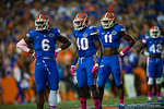 Florida Gators defensive lineman Dante Fowler, Jr., Florida Gators linebacker Jarrad Davis and Neiron Ball look to the sideline during the first quarter.  Florida Gators vs LSU Tigers.  October 11th, 2014. Gator Country photo by David Bowie.