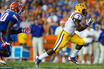 LSU Tigers running back Leonard Fournette  finds an open hole and sprints downfield during the second quarter.  Florida Gators vs LSU Tigers.  October 11th, 2014. Gator Country photo by David Bowie.
