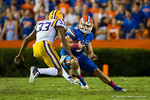 Florida Gators quarterback Jeff Driskel attempts to cut back to avoid the tackle by LSU Tigers safety Jamal Adams.  Florida Gators vs LSU Tigers.  October 11th, 2014. Gator Country photo by David Bowie.