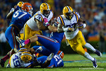 LSU Tigers running back Kenny Hilliard gets the handoff and finds the open hole with the help of his offensive line and their blocking.  Florida Gators vs LSU Tigers.  October 11th, 2014. Gator Country photo by David Bowie.