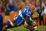 Florida Gators defensive lineman Alex McCalister sacks LSU Tigers quarterback Anthony Jennings during the first quarter.  Florida Gators vs LSU Tigers.  October 11th, 2014. Gator Country photo by David Bowie.