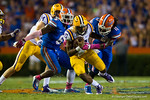 LSU Tigers quarterback Anthony Jennings avoids the sack by Florida Gators linebacker Neiron Ball.  Florida Gators vs LSU Tigers.  October 11th, 2014. Gator Country photo by David Bowie.