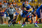 Florida Gators quarterback Jeff Driskel is tackled by an LSU Tigers defender during the second quarter.  Florida Gators vs LSU Tigers.  October 11th, 2014. Gator Country photo by David Bowie.