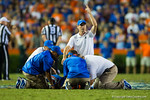 The Florida Gators training and medical staff attend to Florida Gators wide receiver Latroy Pittman during the fourth quarter.  Florida Gators vs LSU Tigers.  October 11th, 2014. Gator Country photo by David Bowie.
