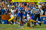 Florida Gators wide receiver Andre Debose makes a LSU Tiger defender miss and sprints upfield on a kick return during the third quarter.  Florida Gators vs LSU Tigers.  October 11th, 2014. Gator Country photo by David Bowie.