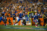 Florida Gators wide receiver Andre Debose receives the punt and sprints downfield and into the endzone to put the Gators up 7-0 Florida Gators vs LSU Tigers.  October 11th, 2014. Gator Country photo by David Bowie.