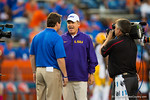 LSU Tigers head coach Les Miles greats Florida Gators Head Coach Will Muschamp at midfield prior to the game.  Florida Gators vs LSU Tigers.  October 11th, 2014. Gator Country photo by David Bowie.
