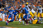 Florida Gators defensive back Brian Poole and defensive end Alex McCalister attempt to keep LSU Tigers running back Leonard Fournette out of the endzone.  Florida Gators vs LSU Tigers.  October 11th, 2014. Gator Country photo by David Bowie.