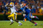 Florida Gators defensive lineman Dante Fowler, Jr. catches up to LSU Tigers quarterback Anthony Jennings and brings him down for the sack.  Florida Gators vs LSU Tigers.  October 11th, 2014. Gator Country photo by David Bowie.