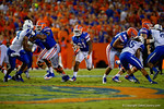 Florida Gators running back Kelvin Taylor explodes through the open hole on his way to a first down during the first half against the Kentucky Wildcats.  Florida Gators vs Kentucky Wildcats.  September 13th, 2014. Gator Country photo by David Bowie.