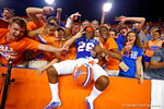 Florida Gators defensive back Marcell Harris leaps into the stands and celebrates with the fans following their win in triple overtime versus the Kentucky Wildcats.  Florida Gators vs Kentucky Wildcats.  September 13th, 2014. Gator Country photo by David Bowie.