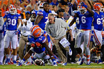 Florida Gators defensive coordinator D.J. Durkin and the Gator players swarm Florida Gators defensive back Brian Poole to celebrate his interception  during the second half against the Kentucky Wildcats. Florida Gators vs Kentucky Wildcats.  September 13th, 2014. Gator Country photo by David Bowie.