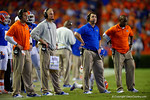 Florida Gators Head Coach Will Muschamp and the Florida Gator coaches watch on from the sideline during overtime.  Florida Gators vs Kentucky Wildcats.  September 13th, 2014. Gator Country photo by David Bowie.