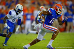 Florida Gators wide receiver Demarcus Robinson makes the reception, turns and sprints downfield for a first down in the first half against the Kentucky Wildcats.  Florida Gators vs Kentucky Wildcats.  September 13th, 2014. Gator Country photo by David Bowie.