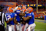 Florida Gators defensive back Keanu Neal is congratulated by his teammates following his interception in the fourth quarter.  Florida Gators vs Kentucky Wildcats.  September 13th, 2014. Gator Country photo by David Bowie.
