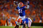 Florida Gators linebacker Michael Taylor signals to the crowd to get loud during the first half against the Kentucky Wildcats.  Florida Gators vs Kentucky Wildcats.  September 13th, 2014. Gator Country photo by David Bowie.
