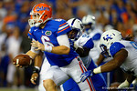 Florida Gators quarterback Jeff Driskel scrambles downfield as Kentucky Wildcats defensive tackle Melvin Lewis tries to make the tackle in the first half.  Florida Gators vs Kentucky Wildcats.  September 13th, 2014. Gator Country photo by David Bowie.