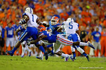 Florida Gators defensive back Marcus Maye makes the diving tackle in the first half on Kentucky Wildcats wide receiver Ryan Timmons.  Florida Gators vs Kentucky Wildcats.  September 13th, 2014. Gator Country photo by David Bowie.