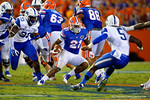 Florida Gators running back Kelvin Taylor cuts to his left in an attempt to avoid Kentucky Wildcats safety Ashley Lowery during the first half against the Kentucky Wildcats.  Florida Gators vs Kentucky Wildcats.  September 13th, 2014. Gator Country photo by David Bowie.