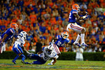 Florida Gators defensive back Keanu Neal leaps into the air in an attempt at an interception in the first half against the Kentucky Wildcats.  Florida Gators vs Kentucky Wildcats.  September 13th, 2014. Gator Country photo by David Bowie.