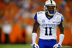 Kentucky Wildcats cornerback J.D. Harmon shows he is pumped up following the Kentucky touchdown to put them up 10-6 in the second half.  Florida Gators vs Kentucky Wildcats.  September 13th, 2014. Gator Country photo by David Bowie.